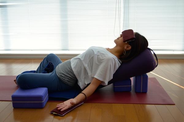 Mayumi Kuhara demonstrating a restorative yoga pose at Be Yoga Japan, Hiroo, Tokyo, Japan