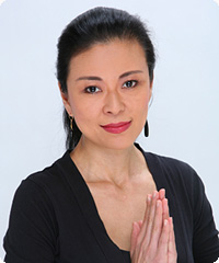 Kumiko Mack, a certified instructor & owner of Be Yoga Japan